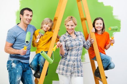 Portrait of a happy family painting wall in green. [url=http://www.istockphoto.com/search/lightbox/9786778][img]http://dl.dropbox.com/u/40117171/family.jpg[/img][/url]
